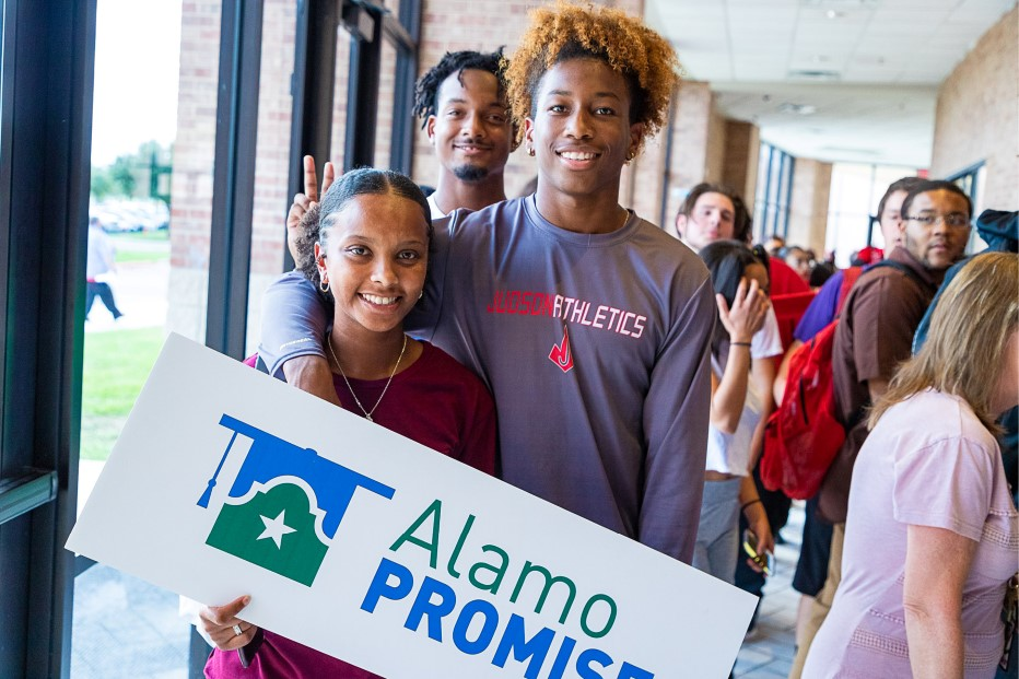 Three Judson Students Pose With AlamoPROMISE Sign