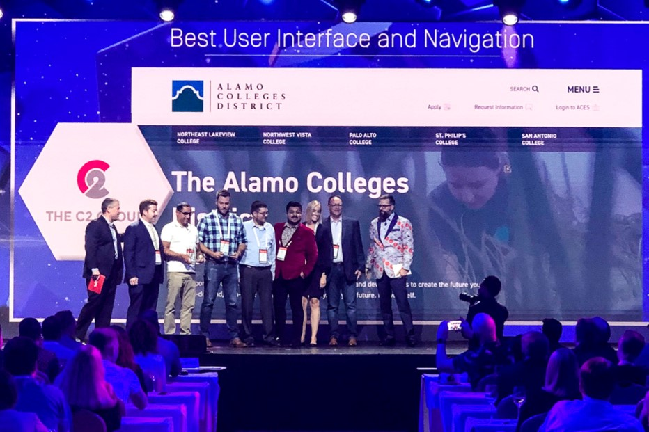 Alamo Colleges and C2 Accepting Award On Stage