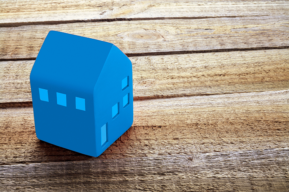 Blue house on a wooden table